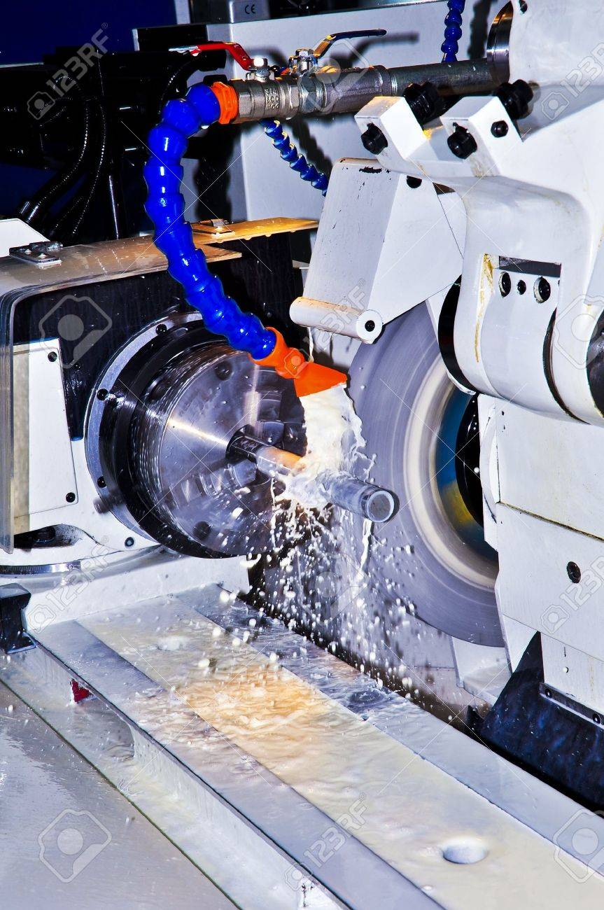 This photo about machine industry, is called cylindrical grinding. Standard-Bild - 12192161