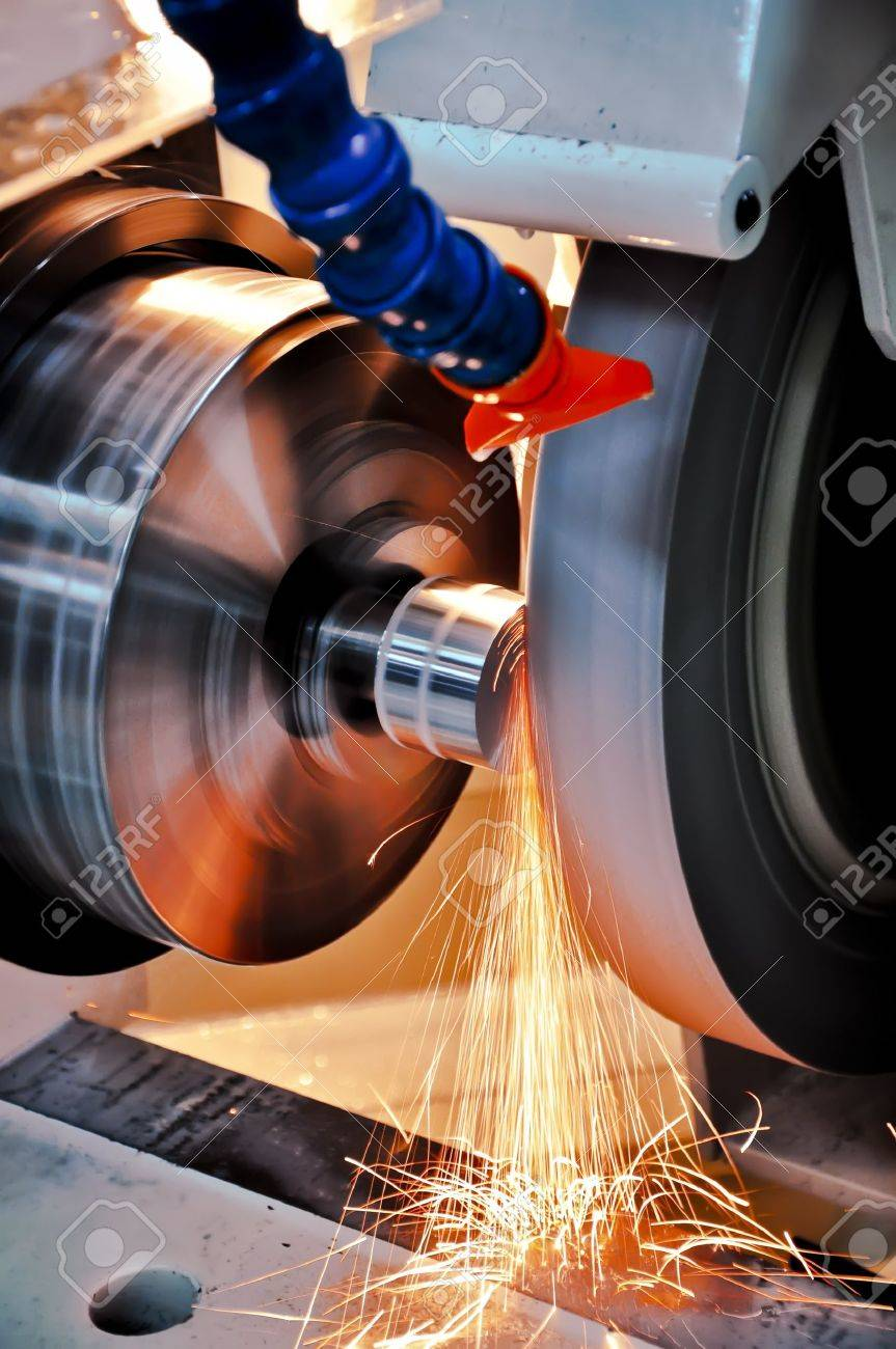 This photo about machine industry, is called cylindrical grinding. Stock Photo - 12192157