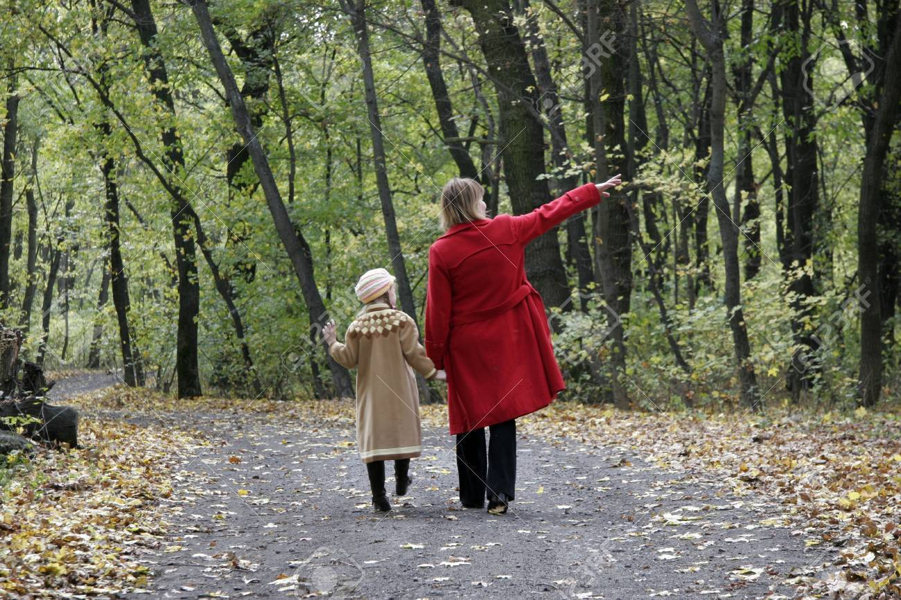 mother and the daughter walking by the autumn forest road Stock Photo - 3720452