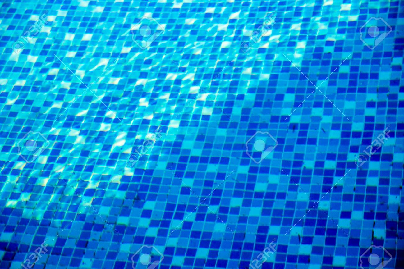 close-up blue mosaic tiles of the swimming pool