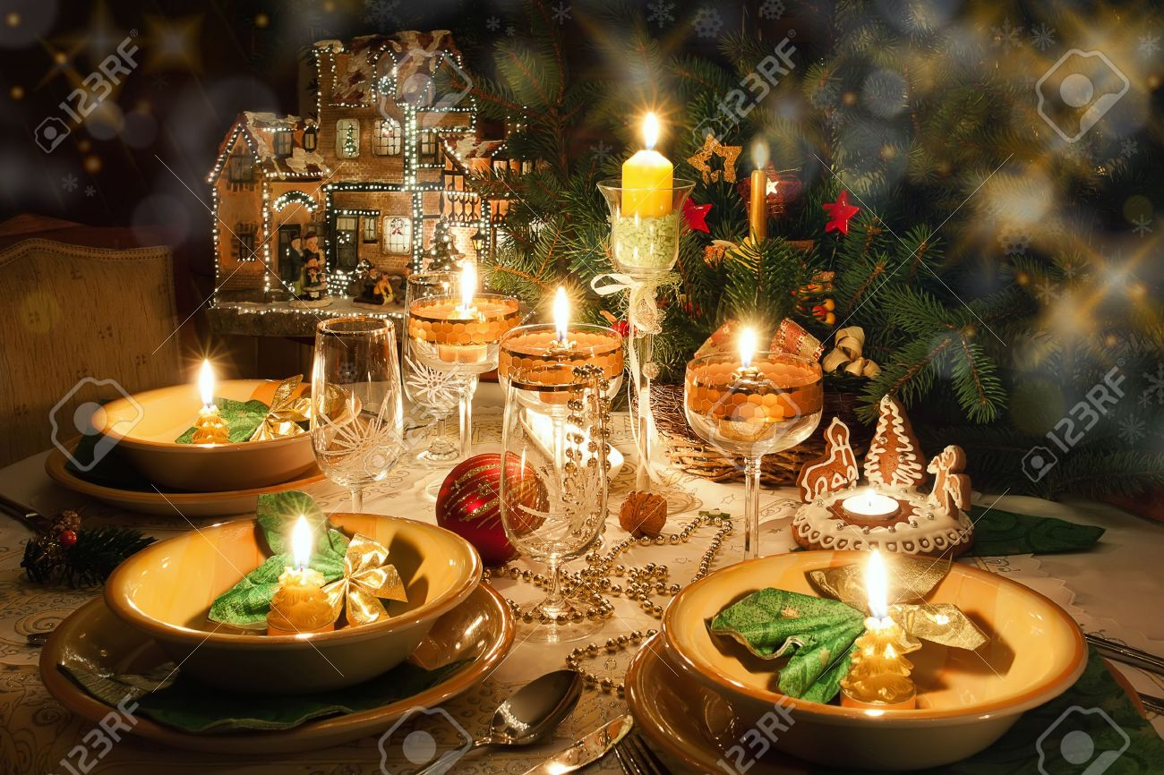 Christmas Dinner Table With Candles With Christmas Atmosphere Stock