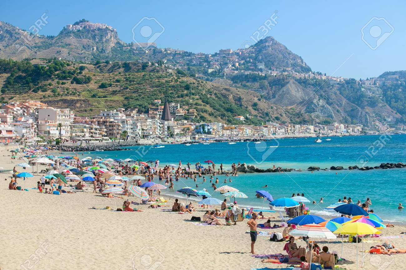 Giardini naxos italy july 2016: group of tourists at the beach