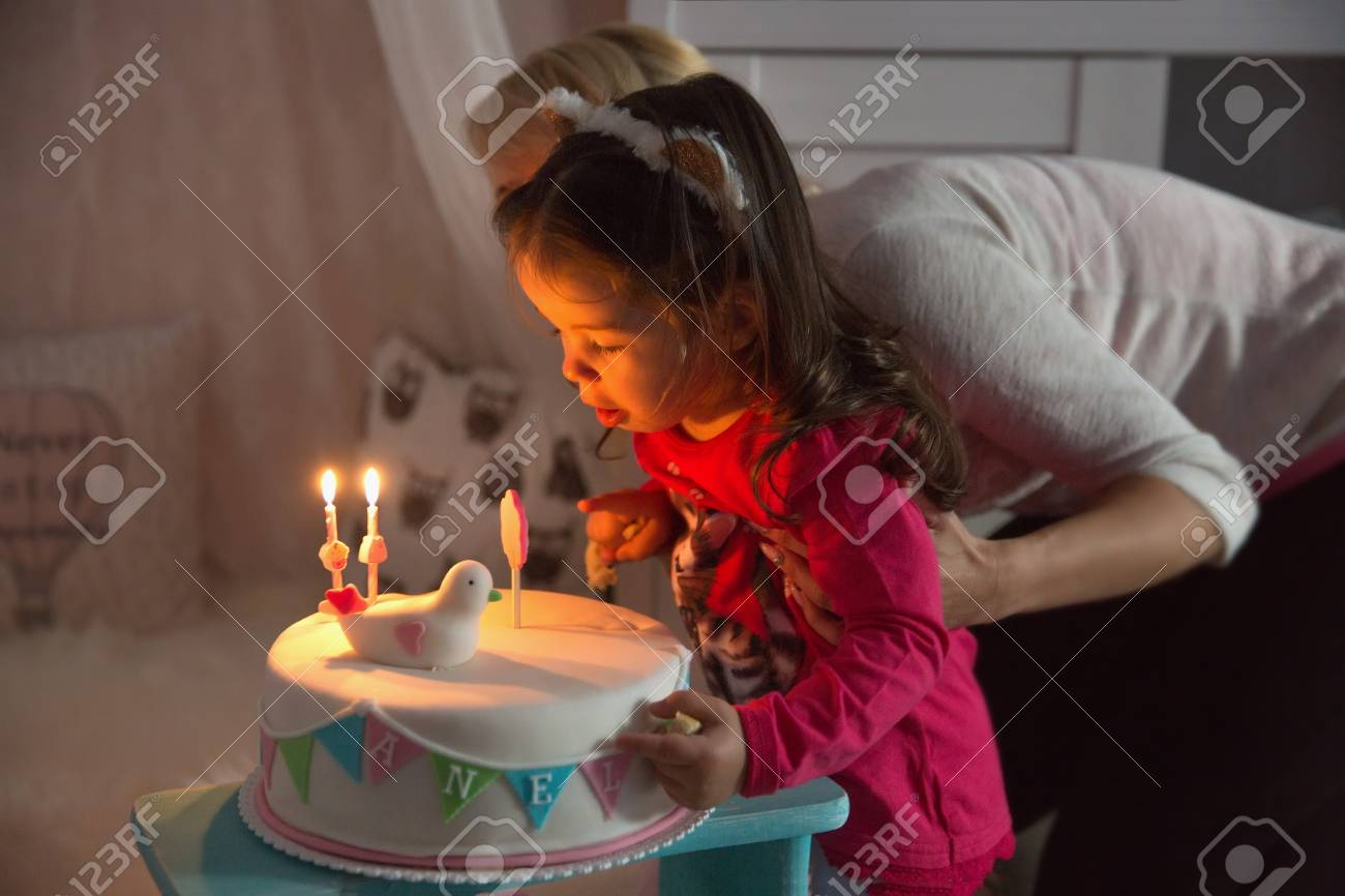 Swell Little Girl Celebrating Her Second Birthday And Blowing On Candles Funny Birthday Cards Online Eattedamsfinfo