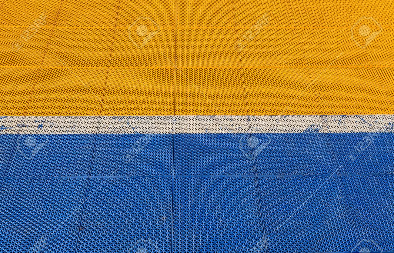 Blue And Yellow Rubber Flooring On Futsal Field Background Stock Photo