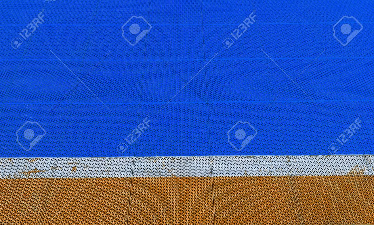 Blaue Und Gelbe Gummi Bodenbelage Auf Dem Feld Hintergrund Futsal