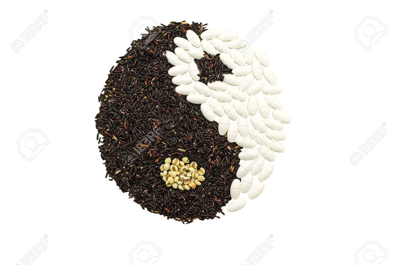 Black Rice And White Pill Forming A Yin Yang Symbol On White Stock