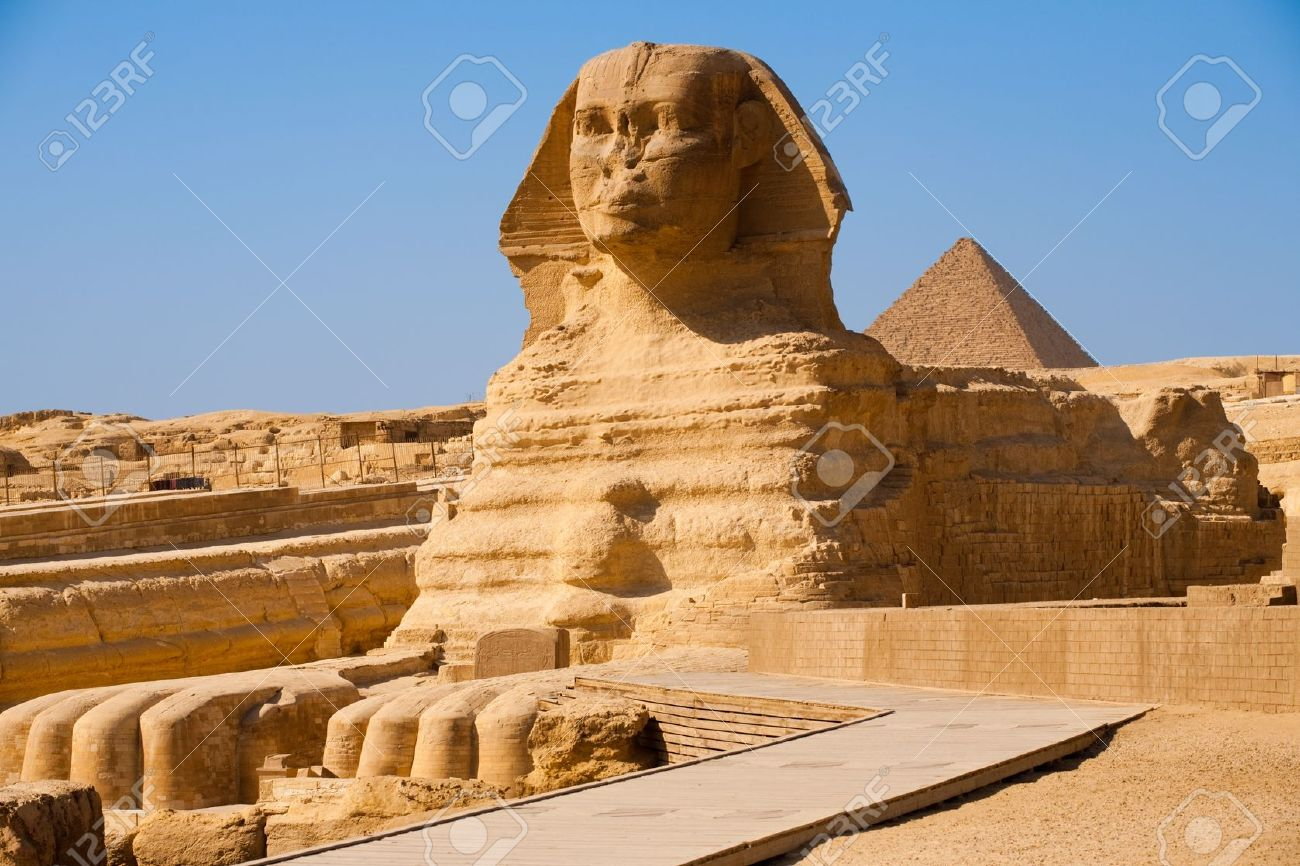 The full profile of the Great Sphinx with the pyramid of Menkaure in the background in Giza, Egypt Stock Photo - 8205606