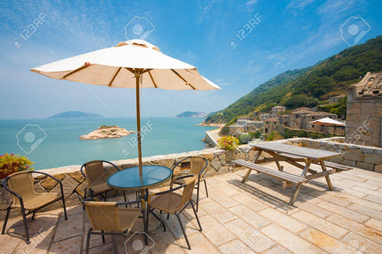 A beautiful view of Turtle island can be seen while relaxing at a rest area viewpoint in the stone village of Qinbi on Beigan island of the Matsu Islands in Taiwan - 12541481