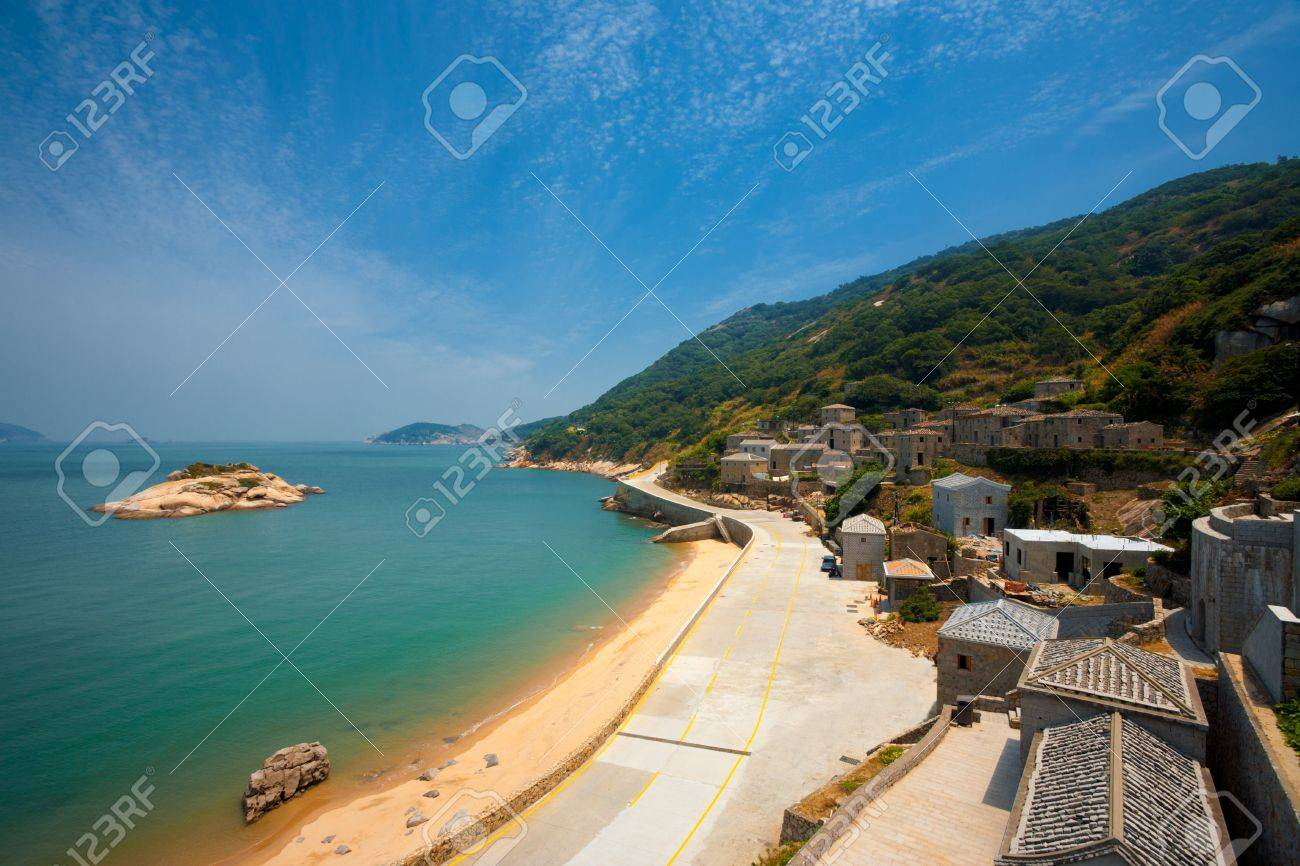 Turtle island is seen just off the coast of Qinbi village, a well preserved ancient village on Beigan Island, the top tourist destination on the Matsu Islands in Taiwan - 12541480