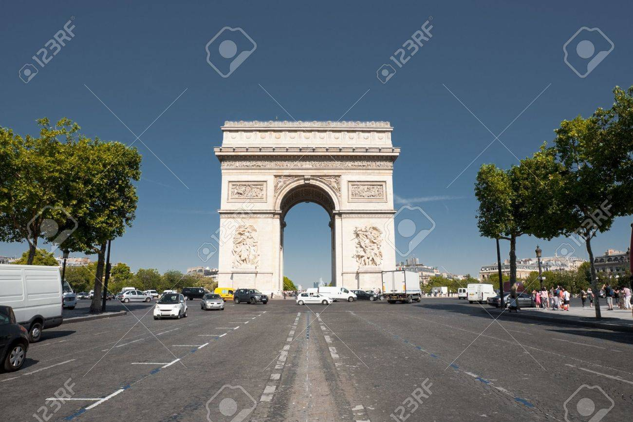 A view down Champs Elysees avenue at the centered iconic Arc De Triomphe in Paris, France. Horizontal. - 12541503