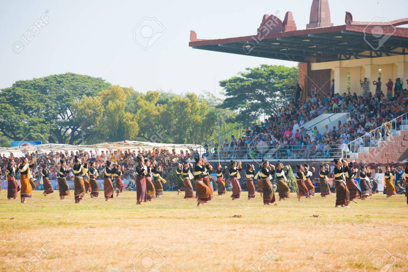 SURIN, ISAN, THAILAND - NOVEMBER 20, 2010: A group of traditionally dressed women dance in front of an audience at the annual Surin Elephant Roundup on November 20, 2010 in Surin, Thailand Stock Photo - 13574448