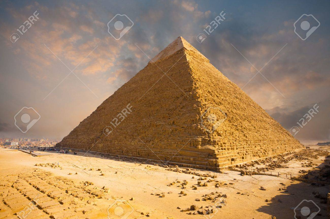 A beautiful fiery sky behind the Giza pyramid of Khafre in Cairo, Egypt - 13699771