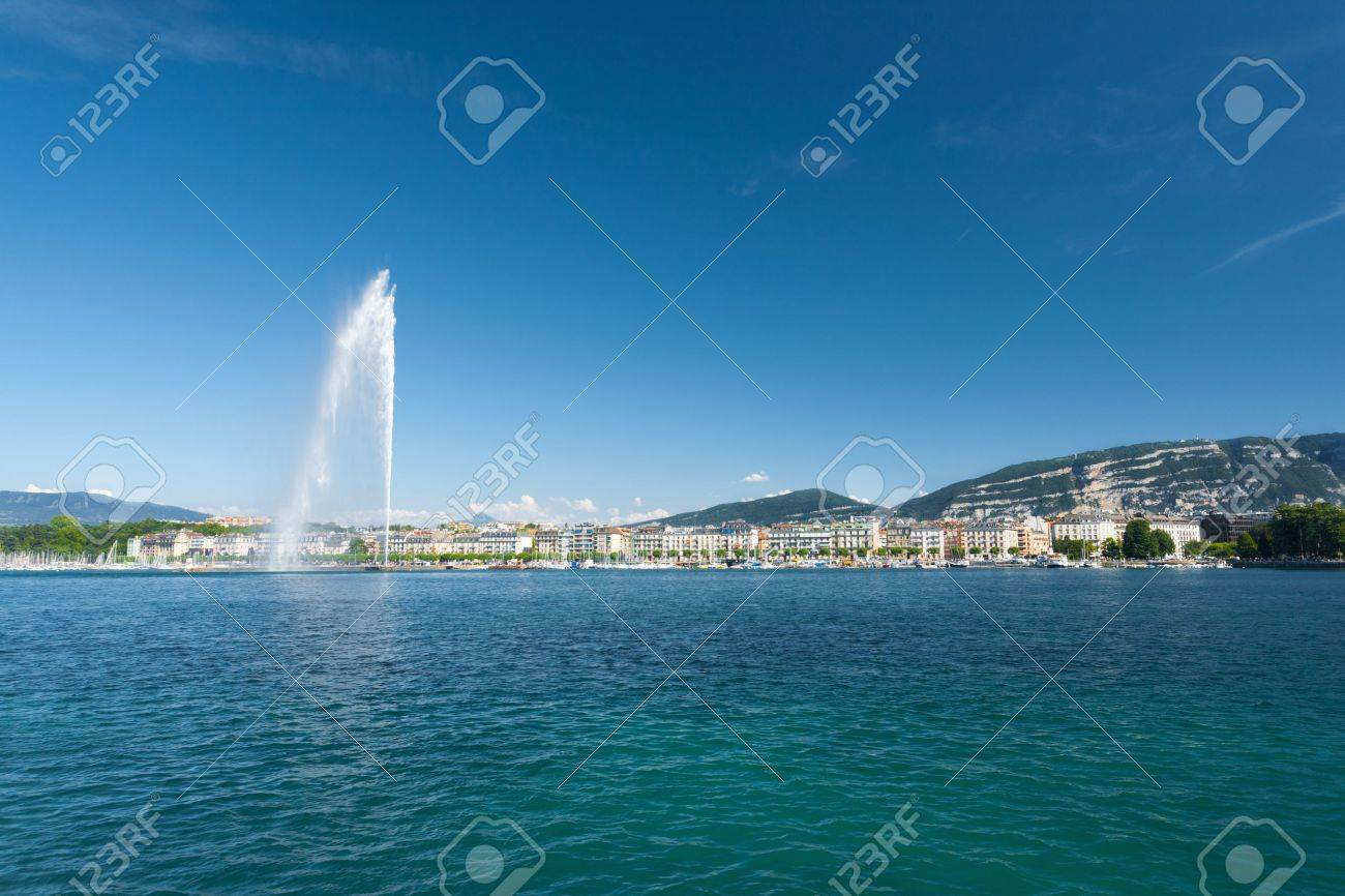 A beautiful view of the Saleve mountain and Jet D'eau water fountain seen from Lake Geneva in Switzerland - 14535029