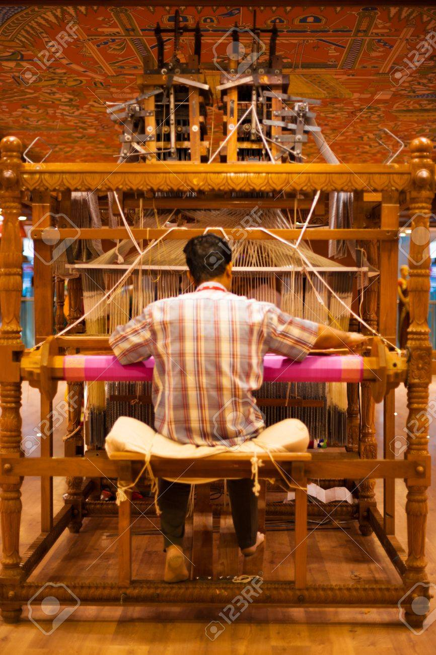 TIRUNELVELI, INDIA - DECEMBER 9, 2009: An unidentified Indian man makes a traditional sari to demonstrate a handloom on December 9, 2009 in Tirunelveli, India - 14681946