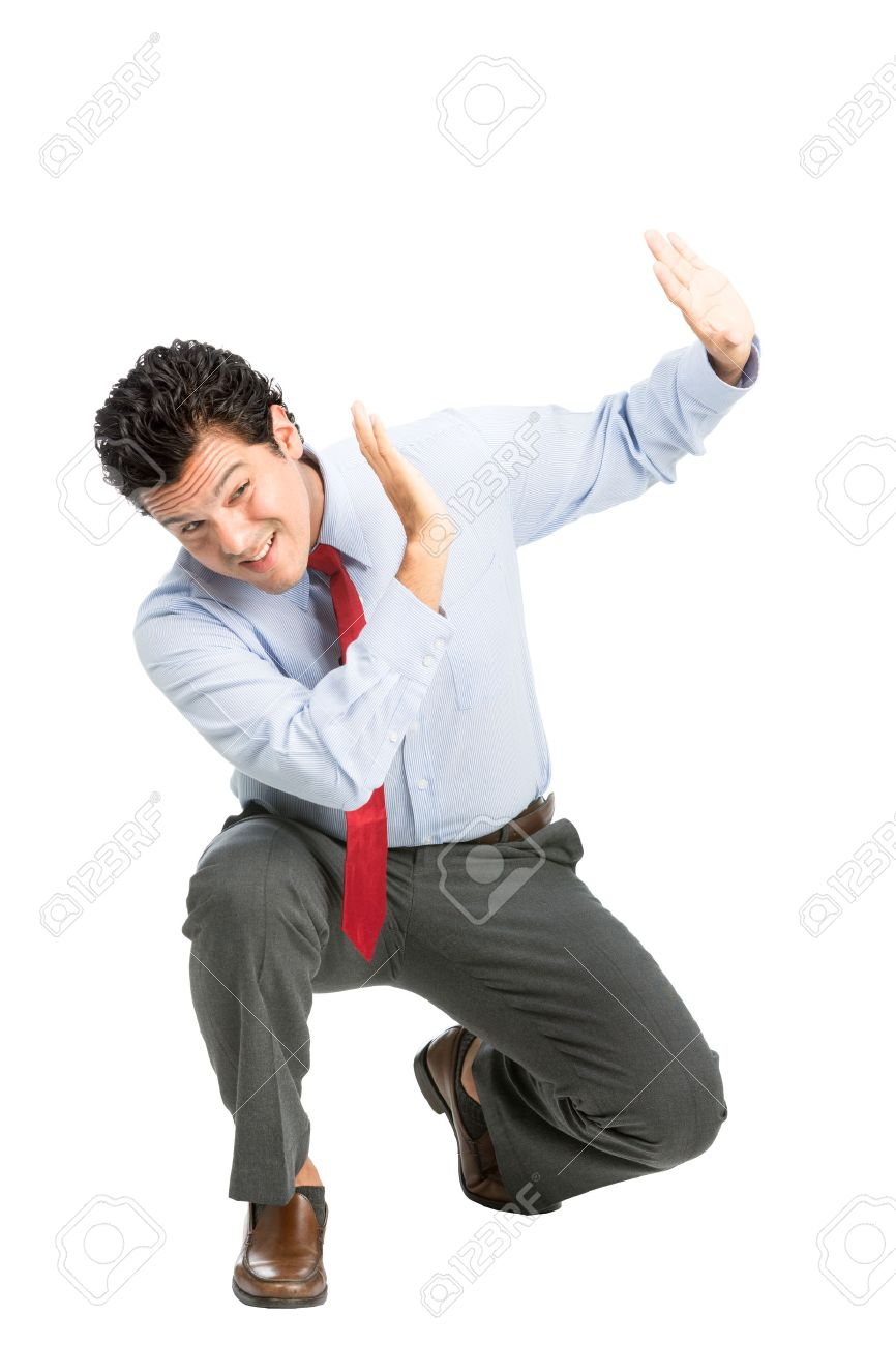 An intimidated latino man office worker in business attire crouching putting hands to shield in self defense, protecting against verbal, physical abuse assault off-screen. Workplace violence - 44195190