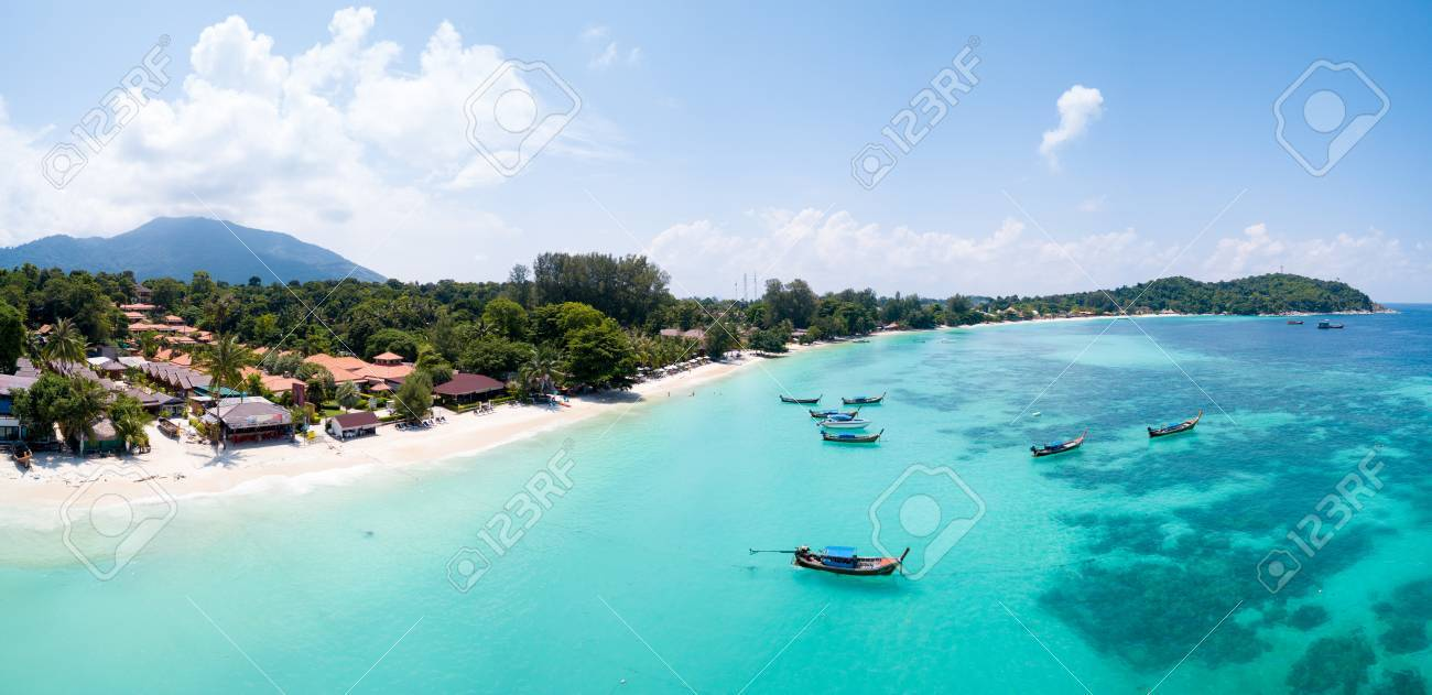 Aerial panoramic view of Pattaya Beach over crystal clear tropical water on island paradise Ko Lipe, Thailand - 85104530