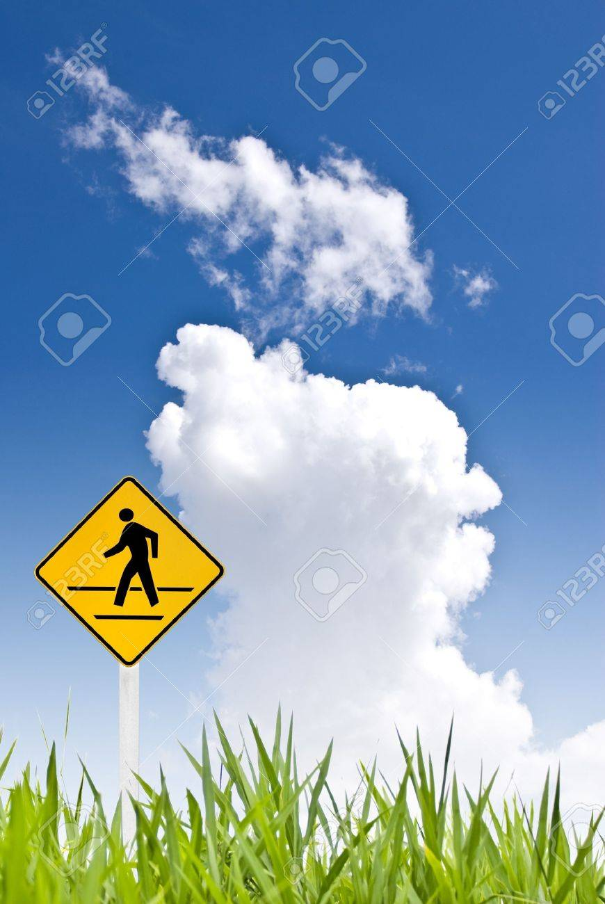 A man walking sign with nice sky Stock Photo - 8418239