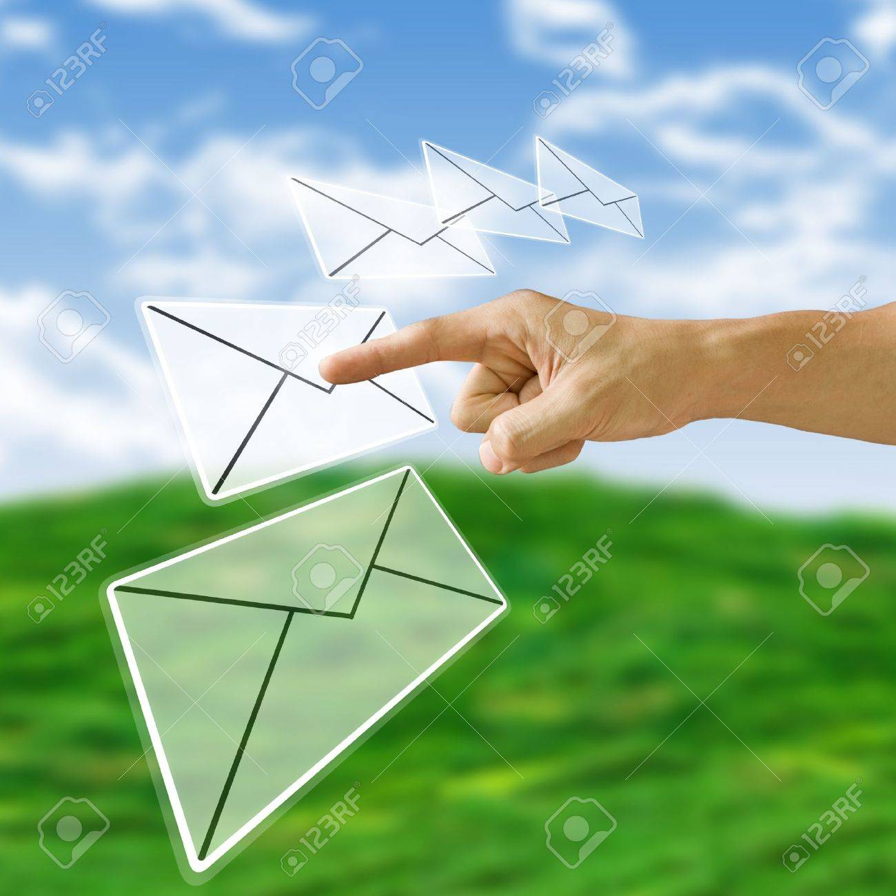 Finger pushing the letter with nature background, Email concept Stock Photo - 9728900