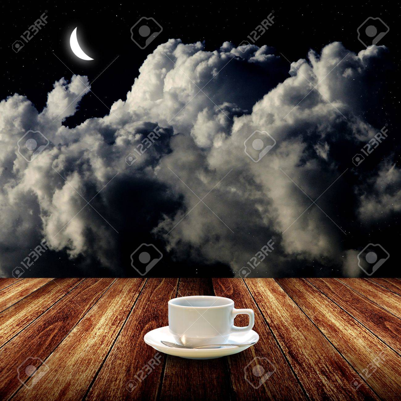 Hot coffee on wooden table with night sky Stock Photo - 14989816