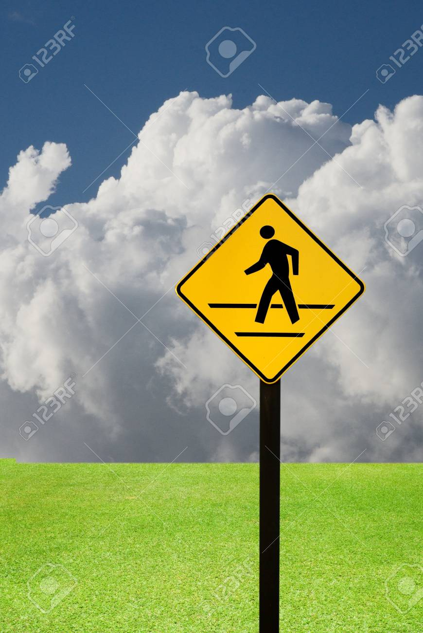Crosswalk sign with a man walking on yellow with nice landscape Stock Photo - 15384082