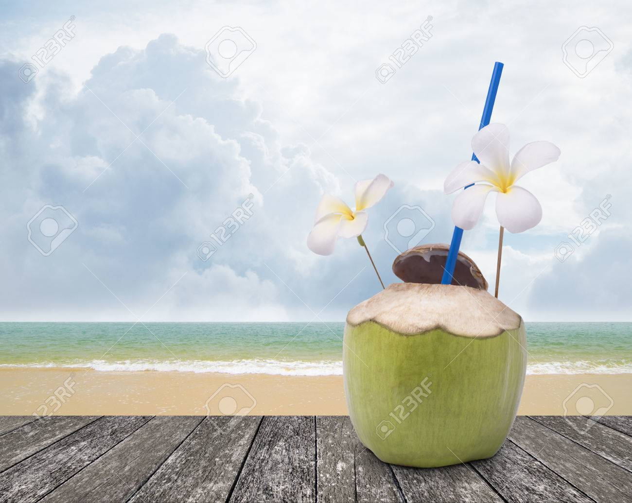 Fresh Coconut Drink With Nice Beach Background Stock Photo