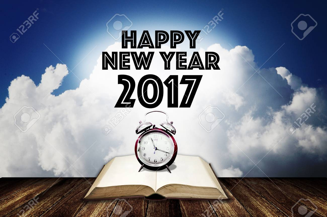 Alarm clock on open book with happy new year greeting word stock alarm clock on open book with happy new year greeting word stock photo 67948779 m4hsunfo