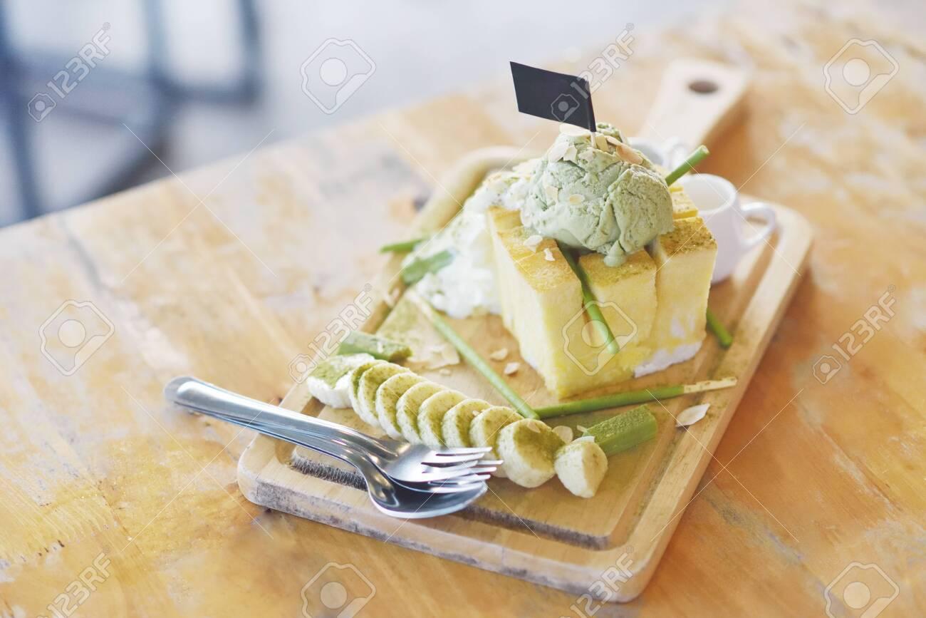 Dessert menu, Honey toast with green tea ice cream and banana sliced - 141437924