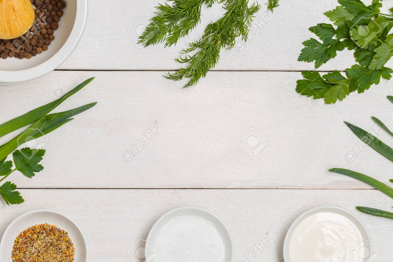 White wooden kitchen table background with healthy cooking ingredients..