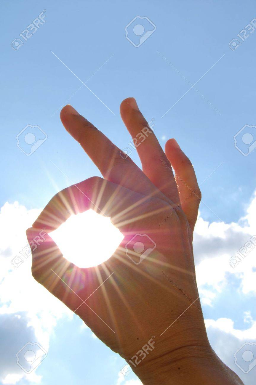 'A OK' sign through sun rays Stock Photo - 4805802