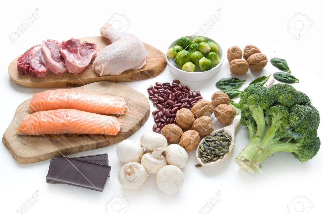 Foods sources for iron including meat, fish, pulses and seeds Stock Photo - 58035860