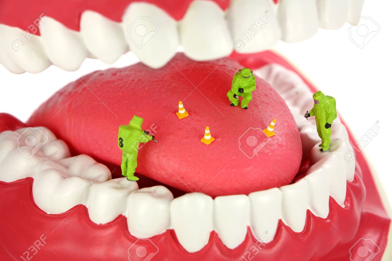Bad breath concept. Miniature HAZMAT team inspects a tongue looking for the source of bad breath odors. Stock Photo - 8949378
