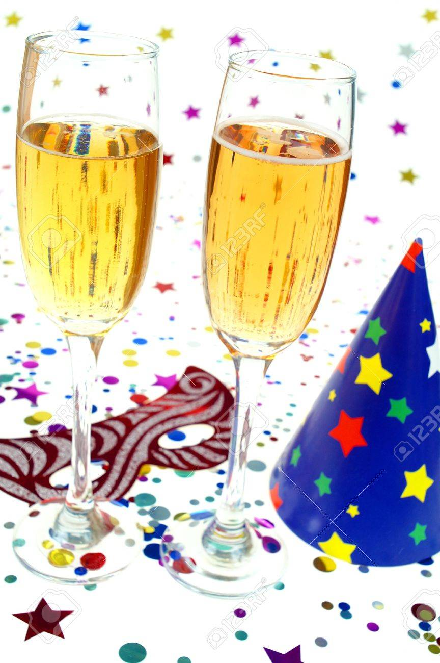 Party cap,mask ,drink and confeti on white background Stock Photo - 2348924