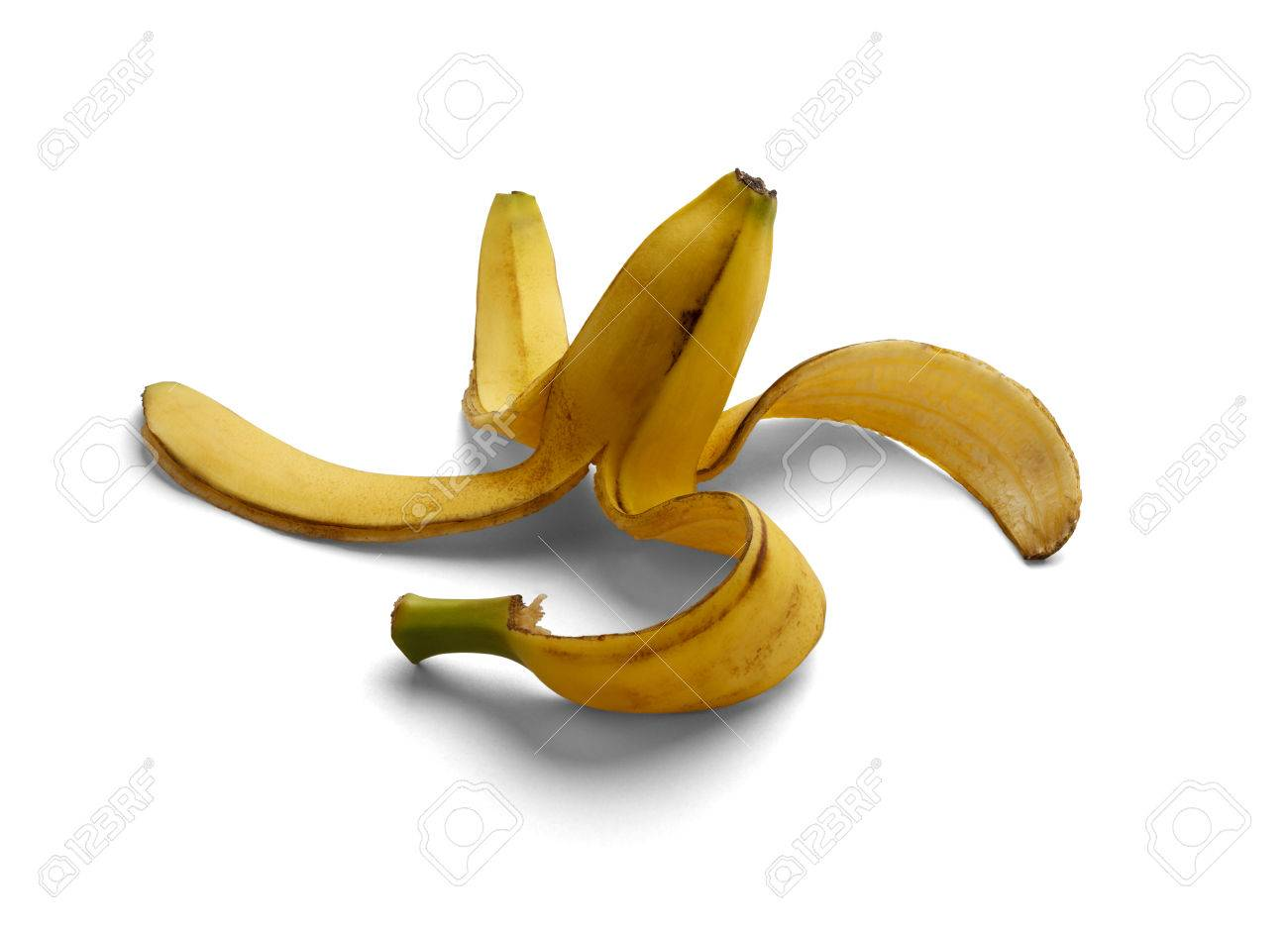 443be6cb791e0 Half Eaten Banana with Peel Laying on Ground Isolated on a White Background.  Stock Photo