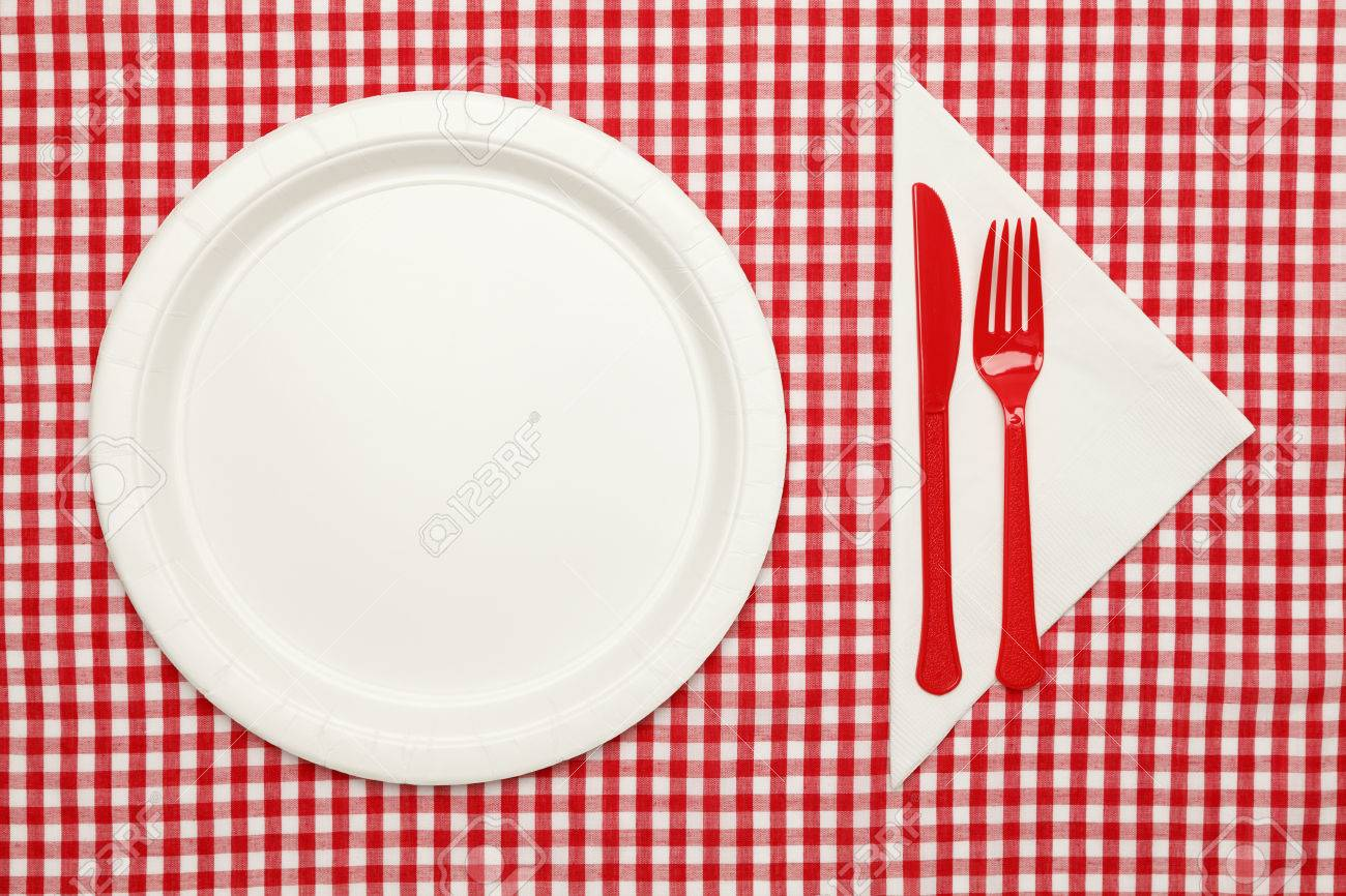 Paper Plate On Checkered Table Cloth Wtih Plastic Utnesils And Napkin.  Stock Photo   38248908