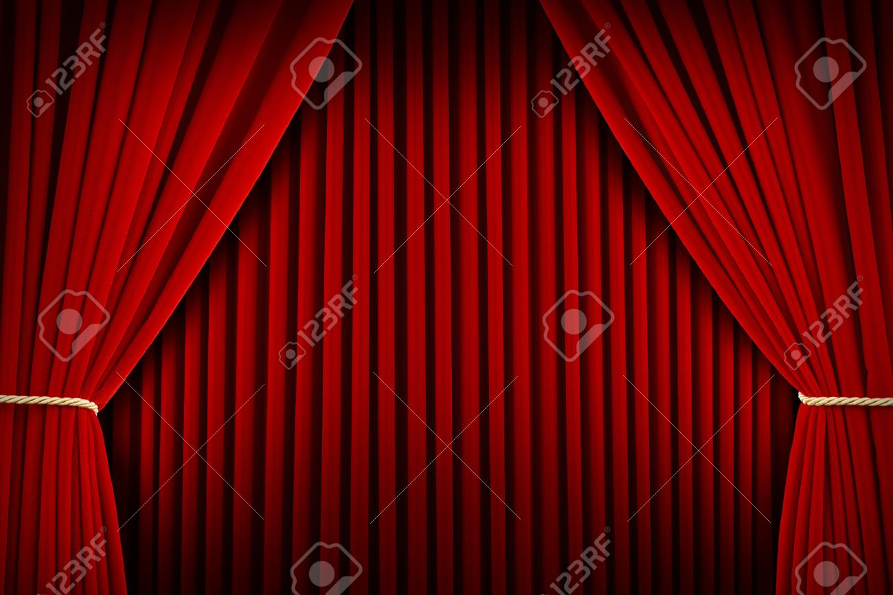 Red Velvet Theater Curtains Pulled Open With Backdrop Stock Photo
