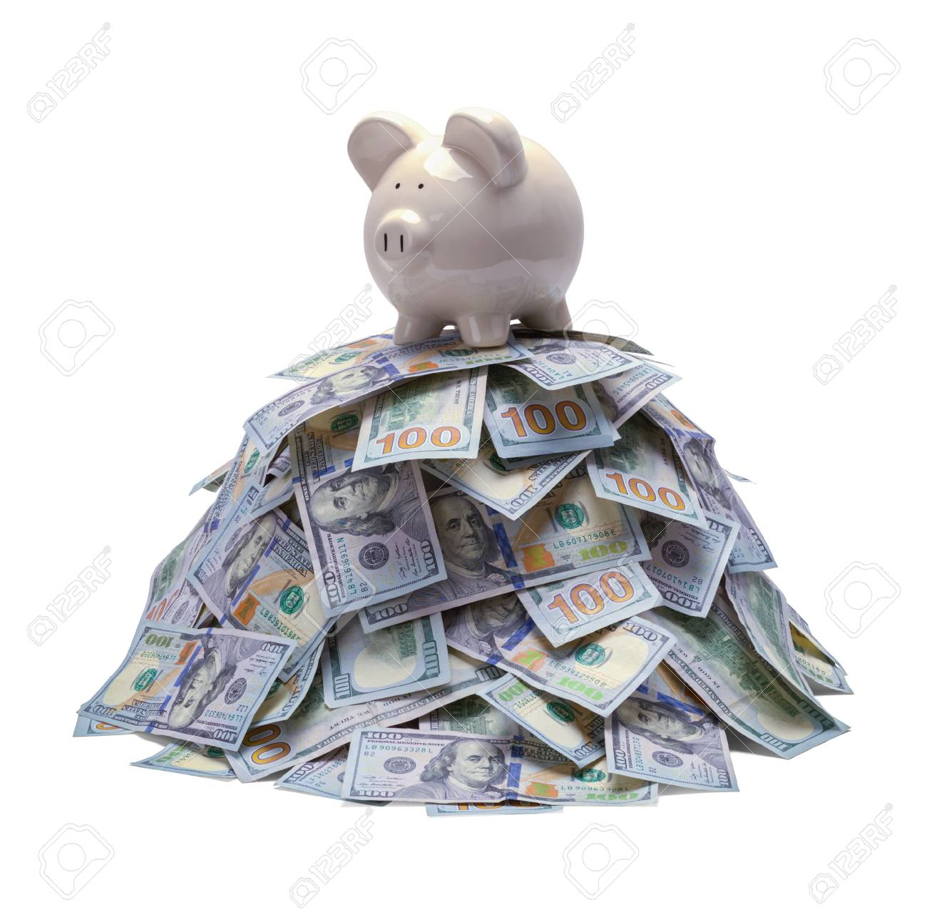 Pile of Money with Piggy Bank on Top Isolated on White. - 104651922