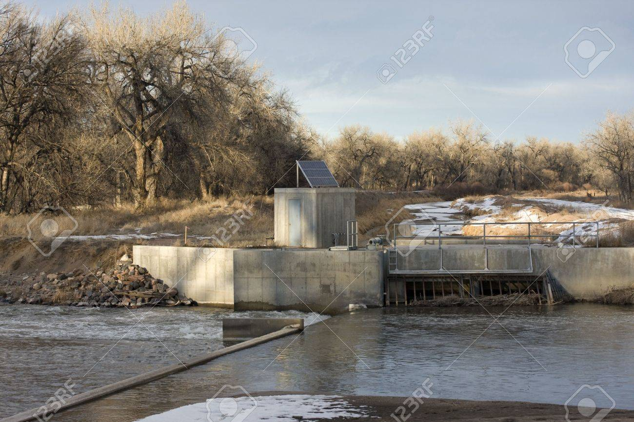 Diversion dam and irrigation ditch on South Platte River in eastern Colorado, entry gate to a channel, water gauge with a solar panel Stock Photo - 2482382
