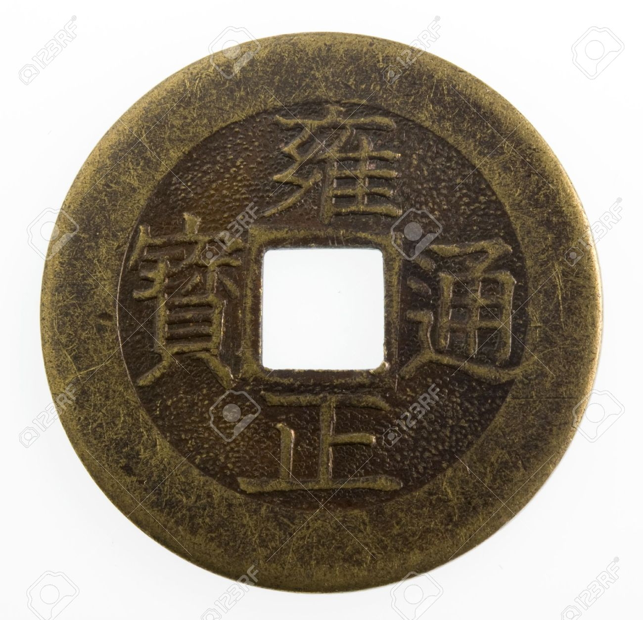 old Japanese coin with a square hole isolated on white Stock Photo - 2800682