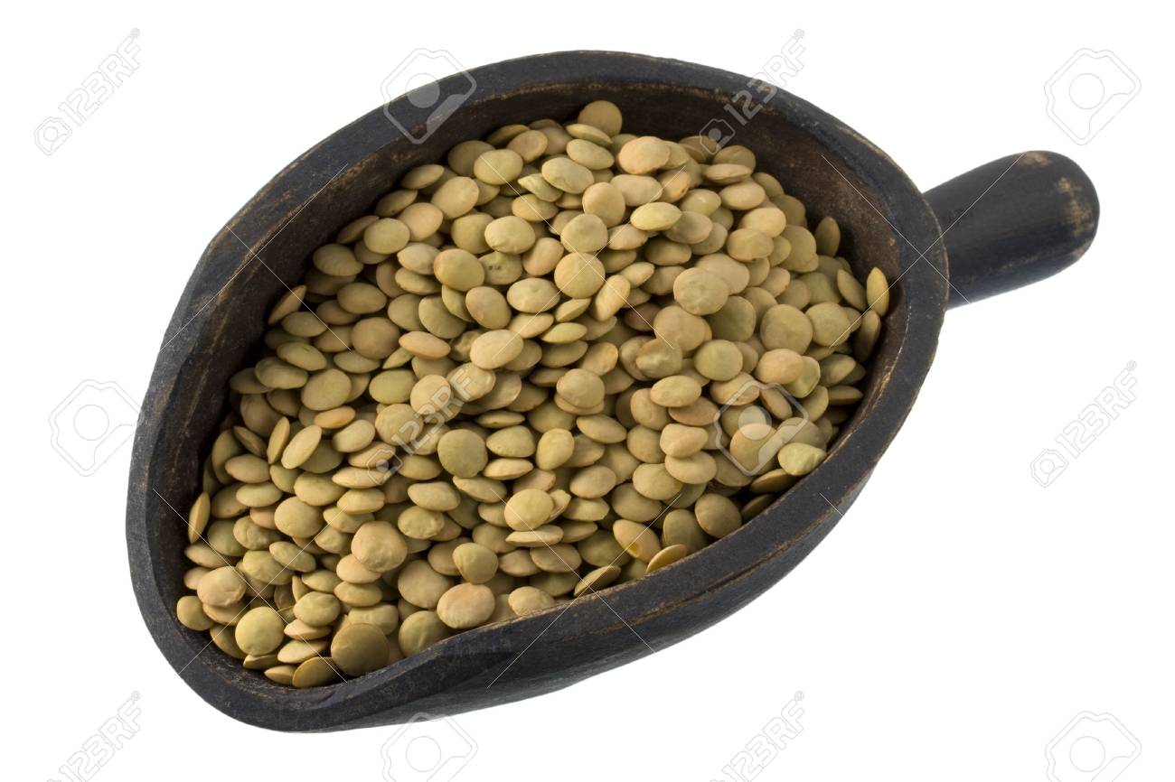 green lentils on a primitive, wooden, dark painted scoop, isolated with clipping path Stock Photo - 3674636