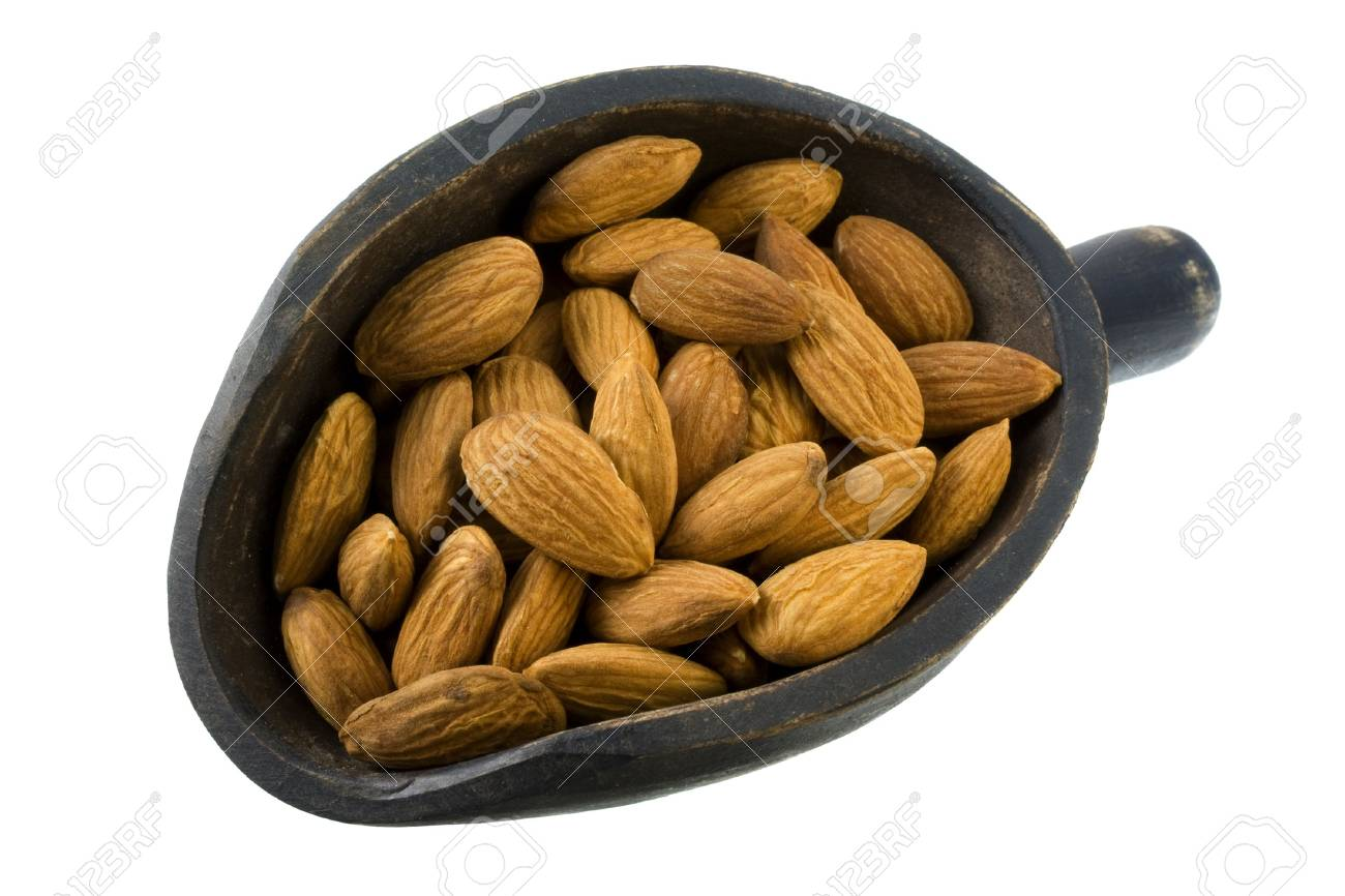 shelled almond nuts on a primitive, wooden, dark painted scoop, isolated on white Stock Photo - 3781504