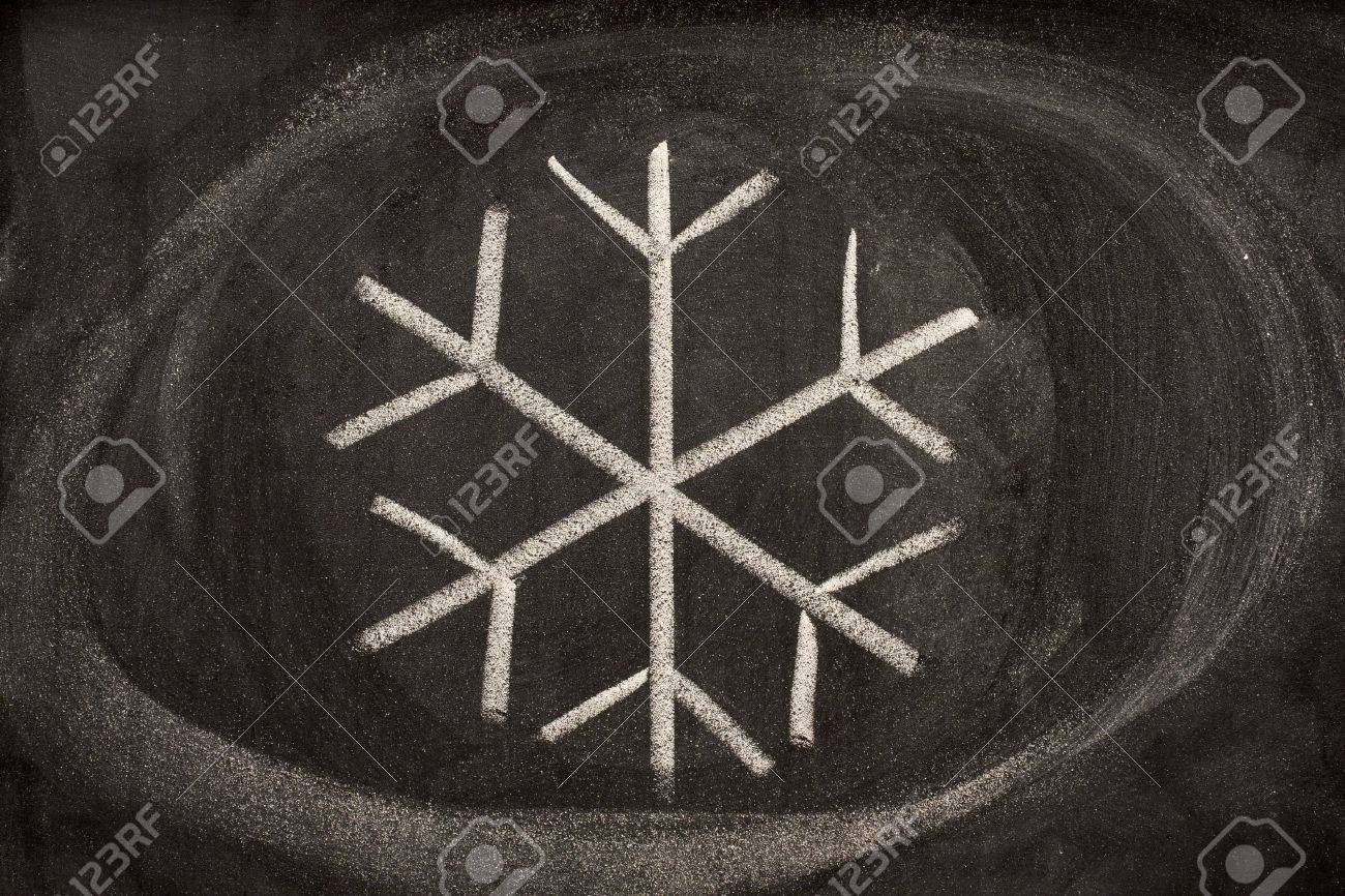 Modern pictorial sign for crystallized water or snow sketched with white chalk on a blackboard. It is used as a symbol for cold, frost, refrigeration and air conditioning. Stock Photo - 3800630