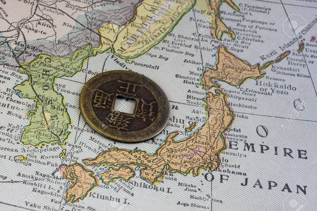 Empire of japan on a vintage map 1926 and old japanese coin empire of japan on a vintage map 1926 and old japanese coin with square gumiabroncs Images