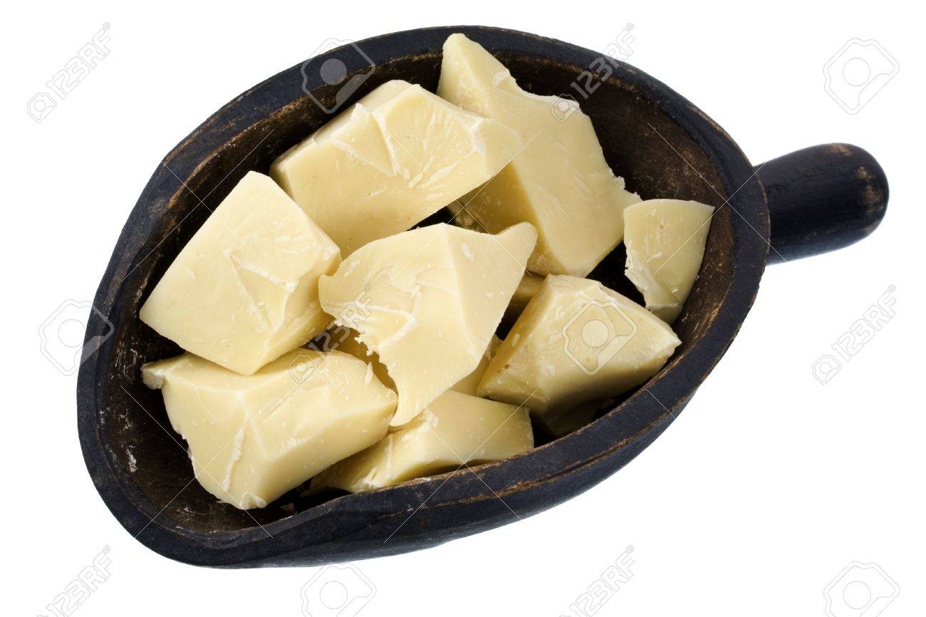 Rough chunks of white chocolate on a primitive, wooden scoop, isolated Stock Photo - 3938945