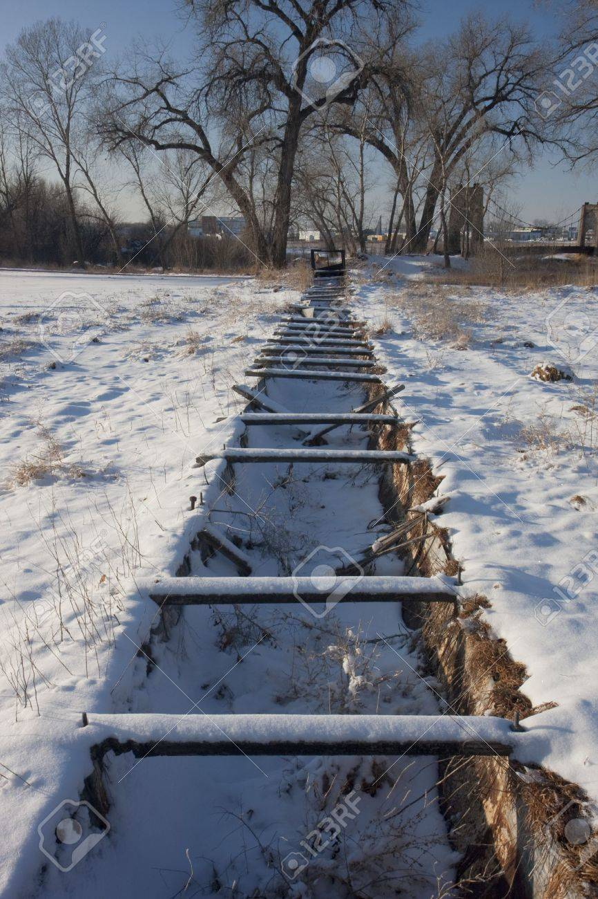 old abandoned irrigation ditch flume and aqueduct in Colorado farmland, winter scenery Stock Photo - 4289819