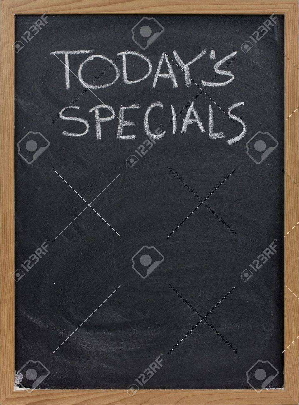today's specials title handwritten with white chalk on blackboard, copy space below Stock Photo - 4677998