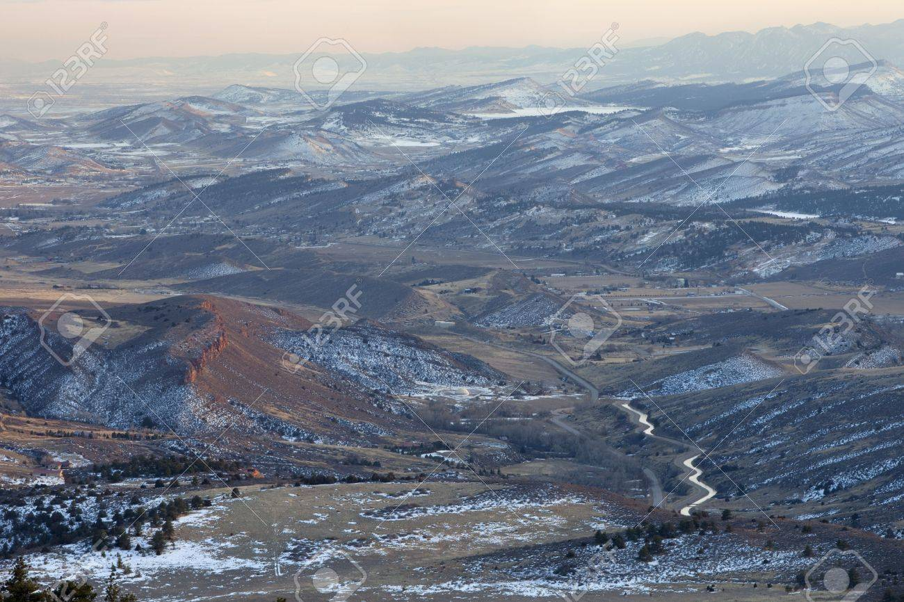 hazy winter view of foothills and Rocky Mountains in Colorado west of Fort Collins showing Big Thompson Project supply canal (transmountain water diversion) and Carter Lake Stock Photo - 6514238