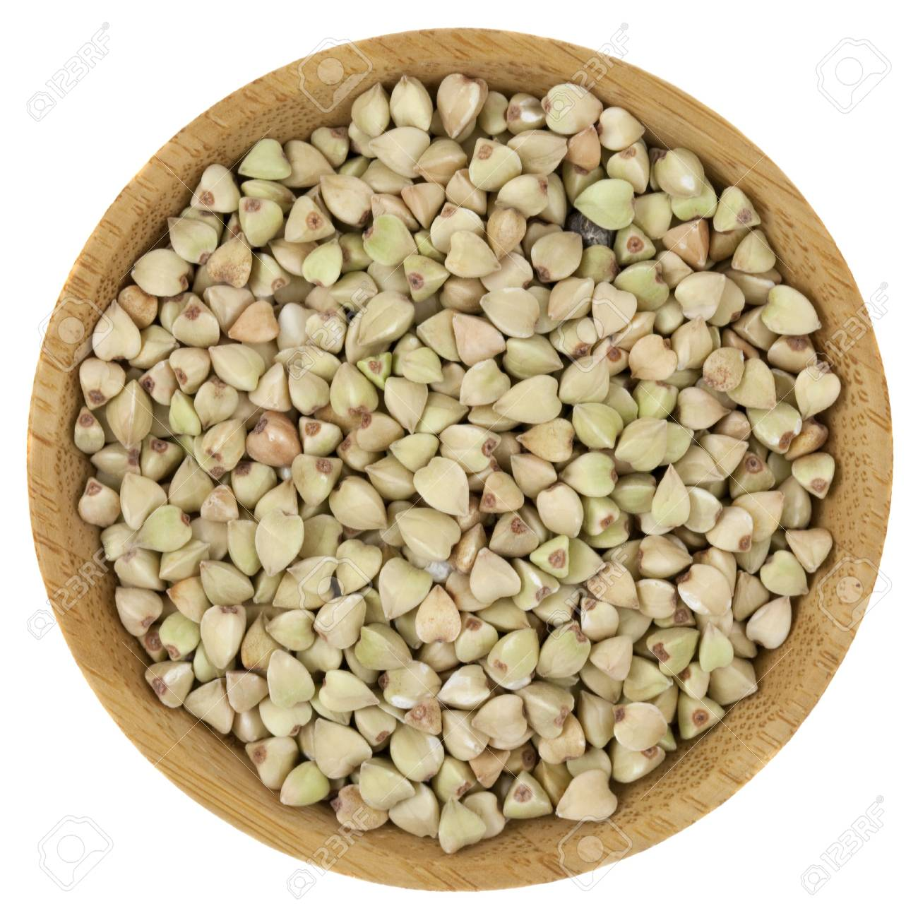 buckwheat groats on a small wooden bowl isolated on white Stock Photo - 6699639