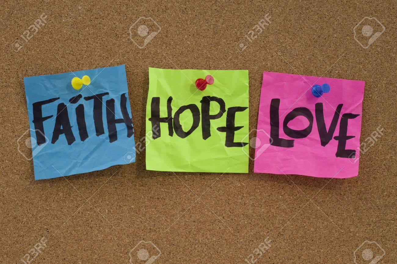 spiritual reminder or methaphysical concept - faith, hope and love handwritten on colorful notes and posted on cork bulletin board Stock Photo - 6881260
