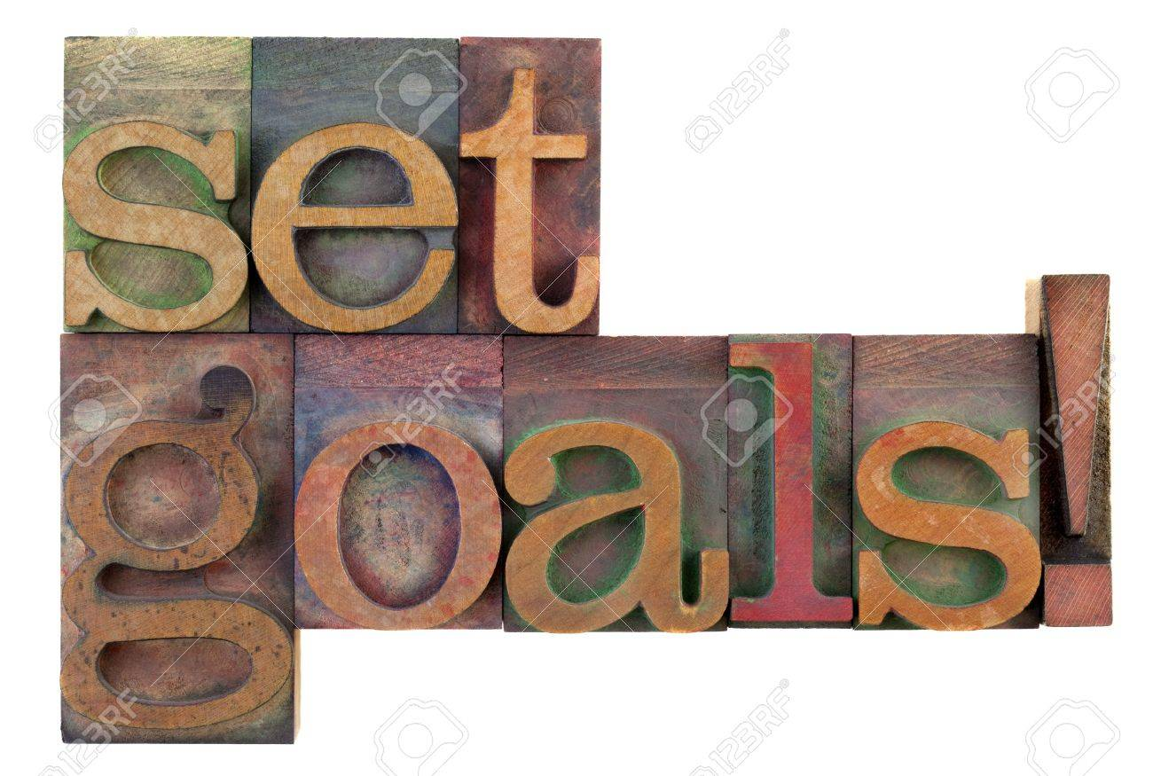Set goals reminder in vintage wooden letterpress type blocks, stained by color ink, isolated on white - 7224443