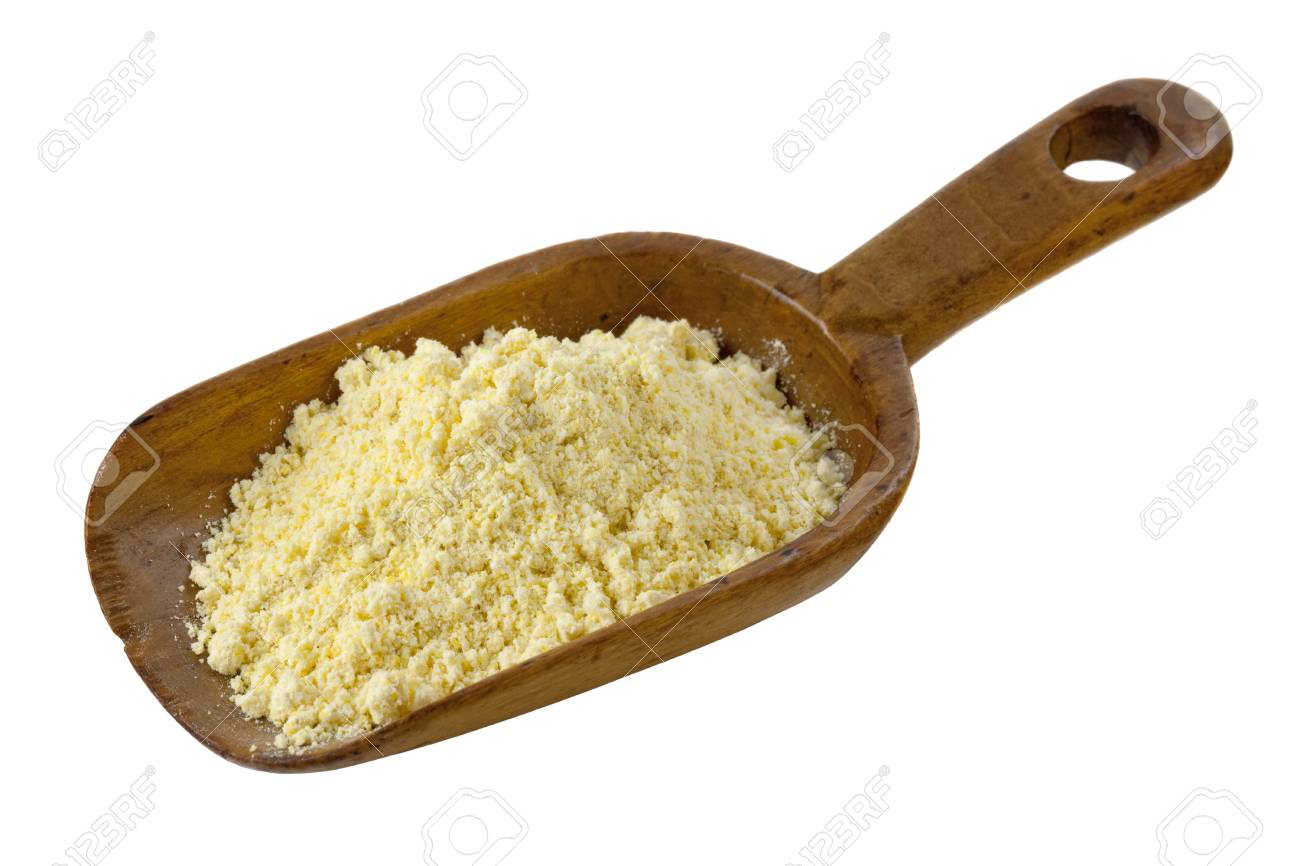 yellow cornmeal on a rustic wooden scoop isolated on white Stock Photo - 7273505